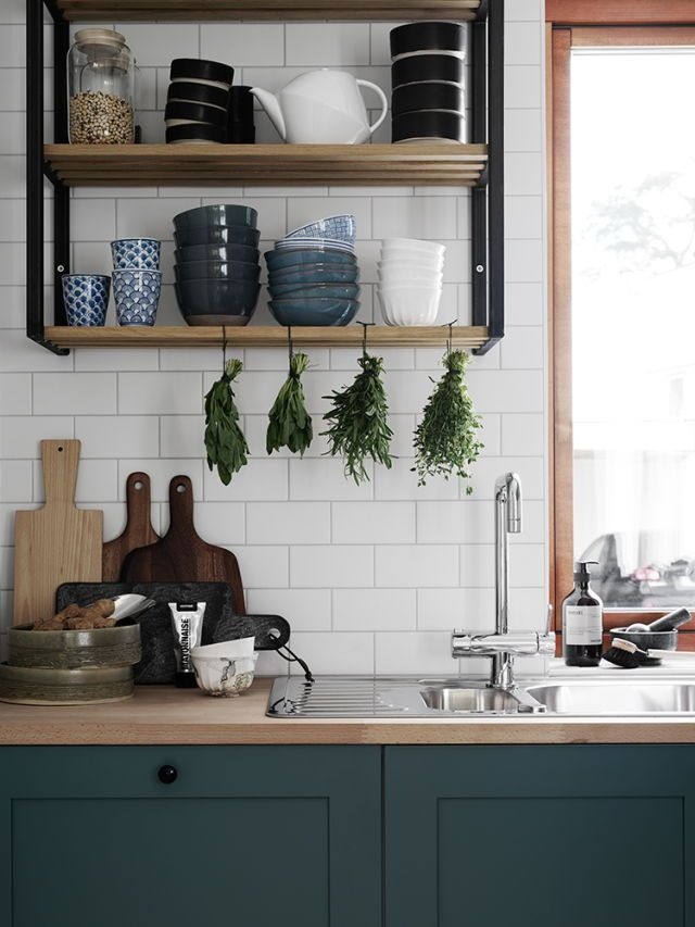 Subway tiles, wooden bench tops and dark cabinetry