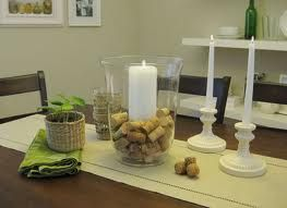 Using your old wine corks inside a big hurricane glass with a candle in the middle makes a nice centerpiece