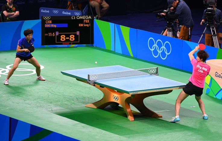 Sing I Kim of North Korea plays against Ning Ding of China during women's singles semifinal in the Rio 2016 Summer Olympic Games at Riocentro - Pavilion 3.