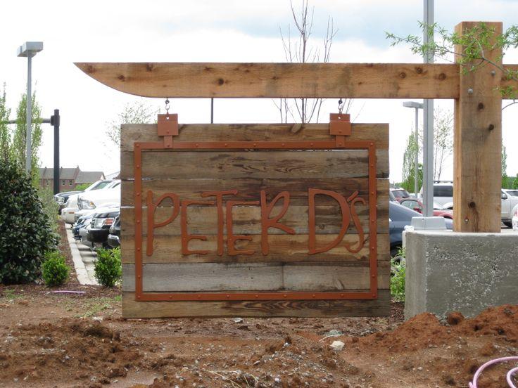 Reclaimed lumber pine signs for Peter D's restaurant in Murfreesboro, TN using barn wood from Eagle Reclaimed Lumber. #reclaimedlumber #barnwood www.eaglereclaimedlumber.com