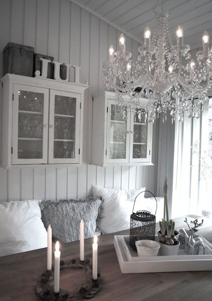 love it all...beautiful grey planked walls, great chandelier, cozy cushy pillows on bench