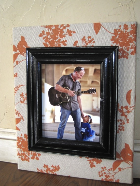I really like this.. a frame set on either a fabric covered canvas or a flat frame covered in fabric..I could do this..
