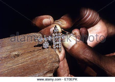 Goldsmith making diamond mangalya in chettinad Tamil Nadu INDIA - Stock Image