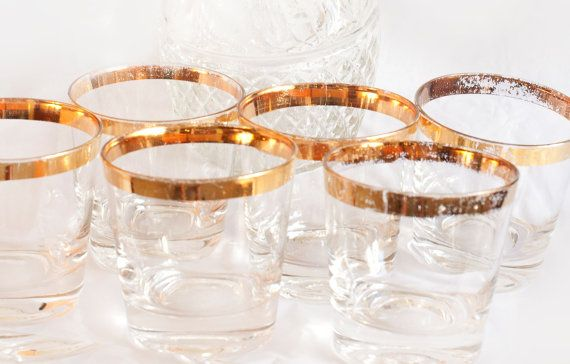 SAVE 40%- Vintage gold rimmed mid century glasses perfect for your bar cart. In Dorothy Thorpe style made popular by Mad Men TV. Don Draper approved!  What you get: 6 Glasses  Size and Markings: 3 D x 3 T no markings  Condition: The glass is great. The gold shows lots of wear consistent with decades of use (see photos).   Would make a nice birthday gift or housewarming gift for anyone who loves vintage.