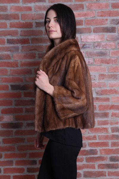 Vintage mink jackets in beautiful condition. Brown has hook and eye closures inside. Red brown has beautiful detailed button.