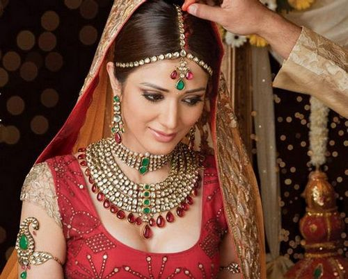 In India red represents:  •color of purity, fertility, love, beauty  •wealth, opulence and power  •used in wedding ceremonies   •a sign of a married woman
