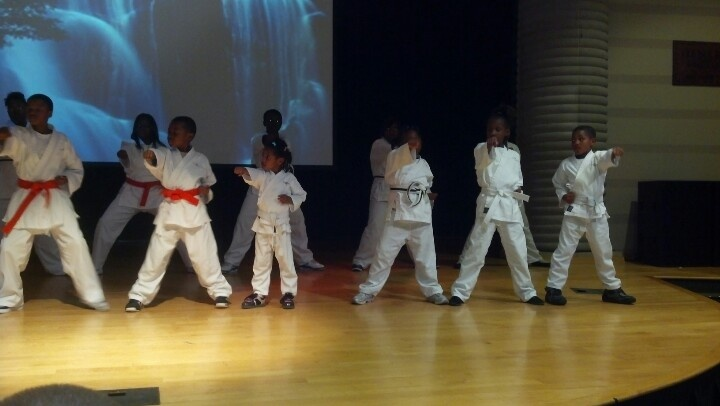 Kids Kicking Cancer kids working on kicks and stances at the Charles H. Wright Museum event.