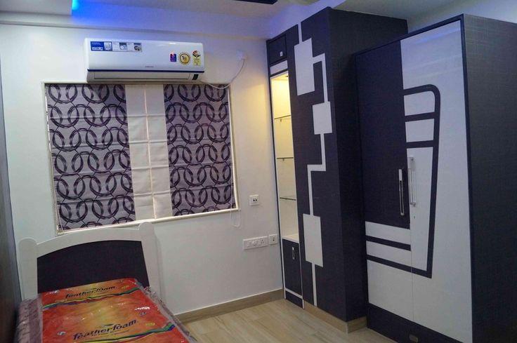 Kids bedroom with window blinds design by arpita doshi for Bengals bedroom ideas