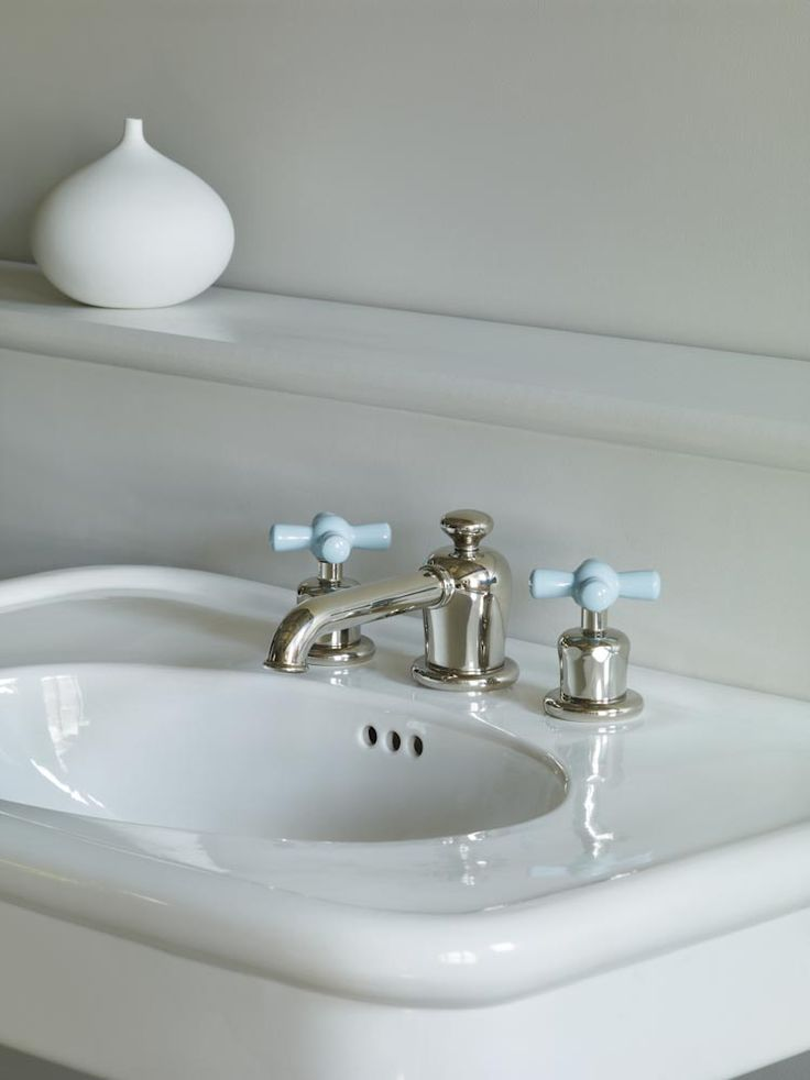 Rockwell three hole deck mounted basin mixer with blue crosshead valves shown here in polished nickel. #blue #taps #Rockwell #watermonopoly www.thewatermonopoly.com