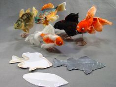 """I use cardstock covered in tape for a resist. I use a thin layer of cormo wool and angora goat curls for the fins.Rather like cobweb felt. I only put the fiber on one side of the fins. This creates a few openings in the body to get the resist out. I put the """"fish"""" in a clear plastic bag and use an electric hand sander until the felt is sticking together and the resist is soggy. Then I pull the resist out and continue felting by hand. If the openings around the fins don't clo"""