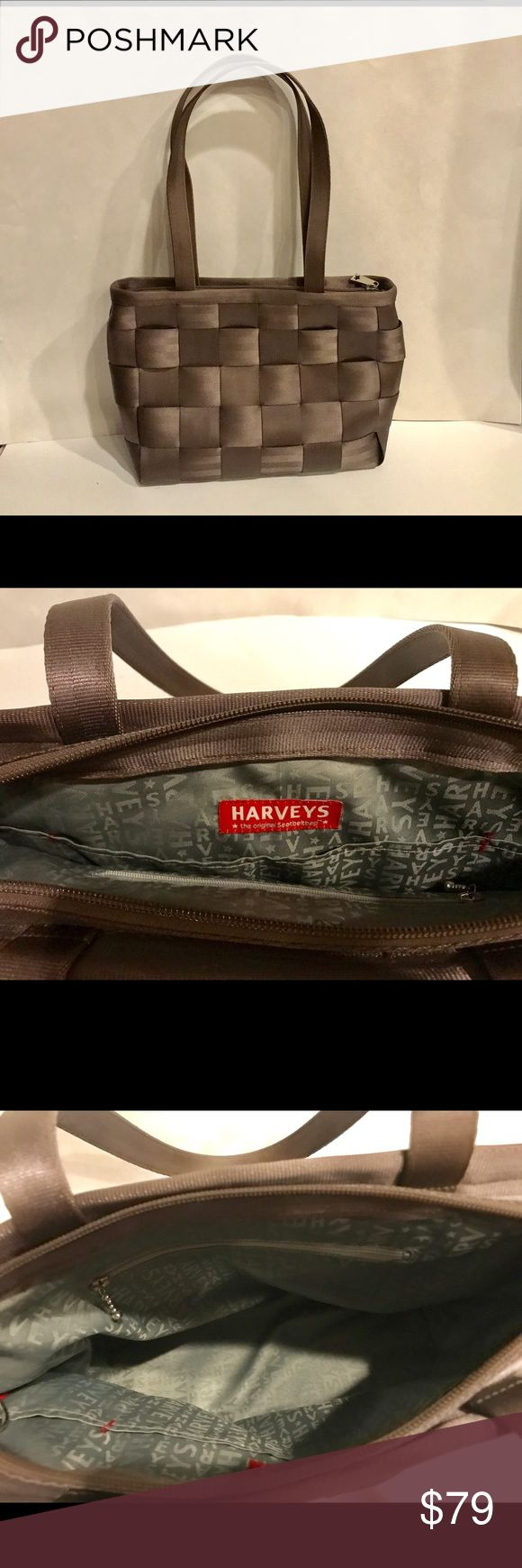 """EUC, & like new, HARVEYS ORIGINAL SEATBELT BAG Dimensions H-11.5 """" x W-15.5"""" x handle drop approximately 3.5-3.75"""". HARVEYS ORIGINAL SEATBELT BAG. EUC, looks as new.! All belts in great shape, no spots ,holes, or rips I can see. Inner lining is pristinely clean.Has large zip pocket and entire bag also zip closure. (gray inner shell) Four bottom feet, silver hardware. This bag is down right funky , brilliant, & so stylin.!!! I've compared prices to this bag as it's a larger style and so EUC…"""
