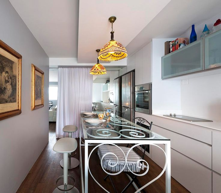 clean small kitchen with customized bar/dining table