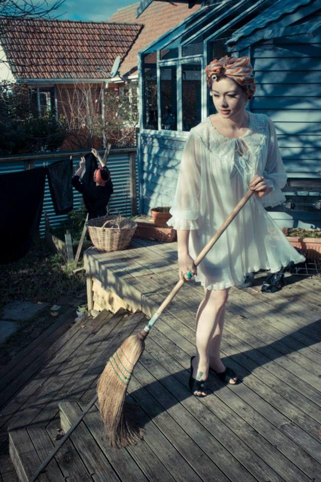 Leda sweeping the deck. Jocelen Janon Photography.