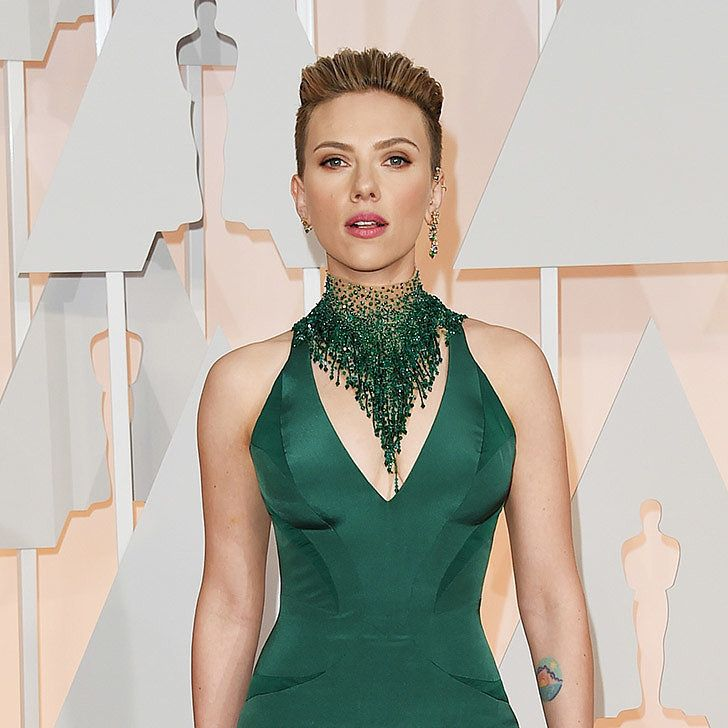 A textured high up 'do adds height and glamour to Scarlett Johansson's emerald ensemble.