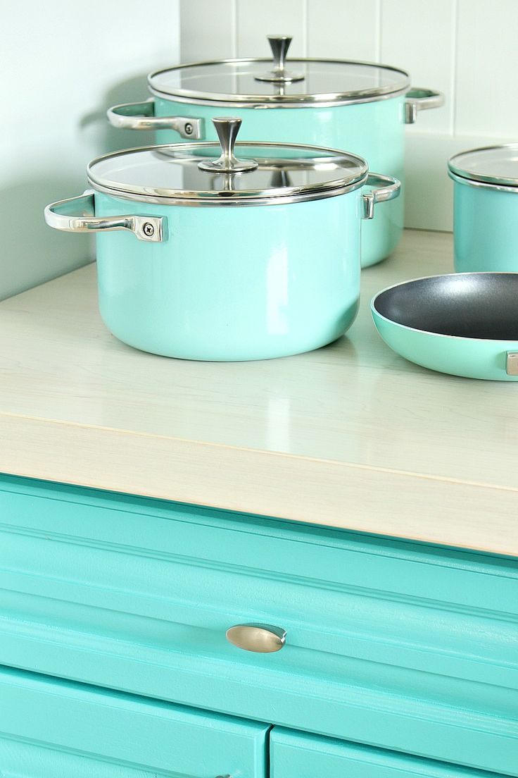 Turquoise Cabinets and Turquoise Kate Spade Pots and Pans - Love the DIY White Stained Maple Counter, Too!
