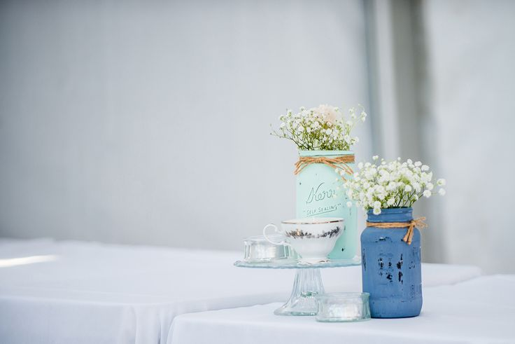 Painted mason jars with small flowers
