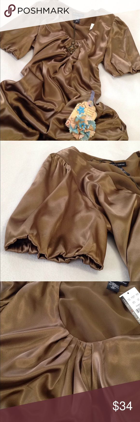 "New York & Company Dress Lined Bronze Shimmer 14 Gorgeous! Silky! Shimmery! This chocolate bronze shade is difficult to describe. The pleated neckline is the best match for true color.(photo 3) Sleeve hem(6"" across)is tufted but does not stretch. (Photo 2) Shell: 98% polyester, 2% spandex.  Lining: 100% polyester. (Photo 4) Machine wash cold. Laying flat: armpit to armpit 21 1/2"", shoulder to front hem 37"", armpit to sleeve hem 4"", across bottom hem 24 1/2"". **Note** props and jewelry not…"