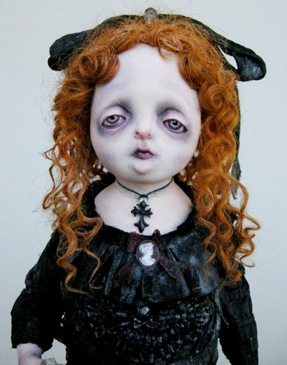 She's sort of ghostie/goth little girl doll. This style reminds me a bit of Gail Lackey's work.