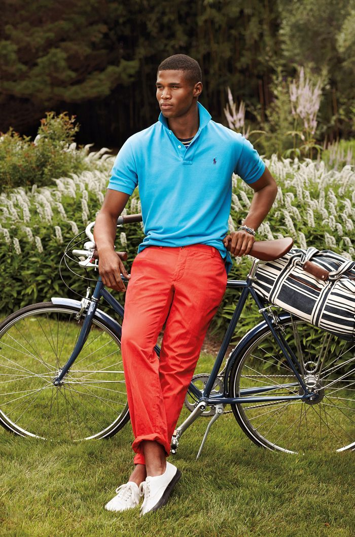 Shop this look on Lookastic:  http://lookastic.com/men/looks/polo-chinos-low-top-sneakers-duffle-bag-bracelet/11388  — Aquamarine Polo  — Silver Bracelet  — Red Chinos  — White Low Top Sneakers  — Black and White Horizontal Striped Canvas Duffle Bag