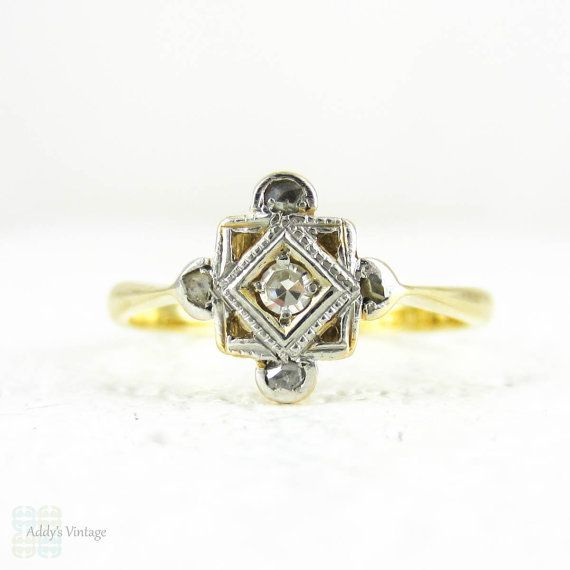 Vintage diamond panel ring in a square shape with a pierced design. In the middle is a larger eight cut diamond in a square shaped setting which is outlined