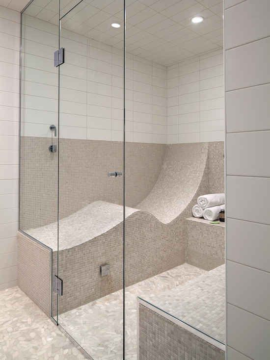 An S-shaped seat turns your shower or steam room into one you can LIE DOWN IN.