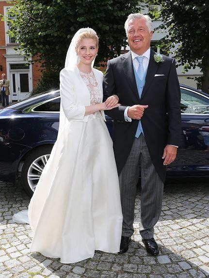 Bride Princess Franziska zu Sayn-Wittgenstein-Berleburg, born Franziska Balzer and her father Thomas Balzer during her wedding to Prince Maximilian zu Sayn-Wittgenstein-Berleburg on August 6, 2016 in Bad Laasphe, Germany.