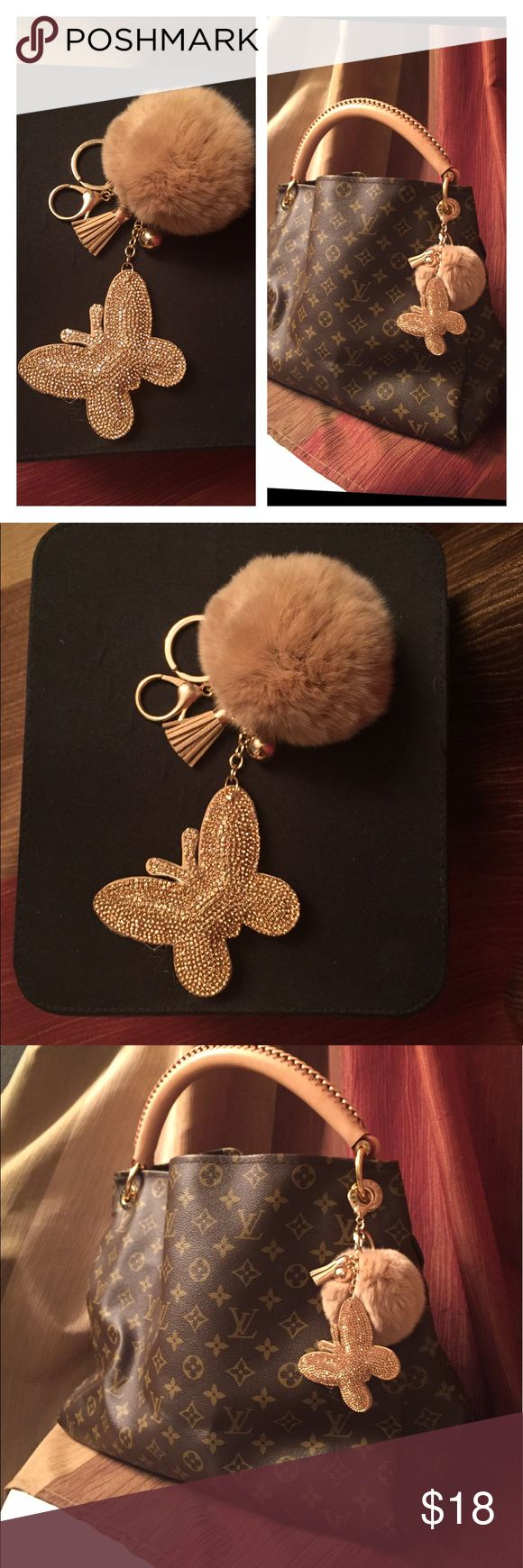 Beautiful keychain handbag charm Beautiful Pom and tassel with a gorgeous butterfly embellished with stones keychain handbag charm. Looks gorgeous on your handbags. This is an absolute must have accessory for your handbag.  Pic of front and back of charm . Price is firm  Accessories Key & Card Holders