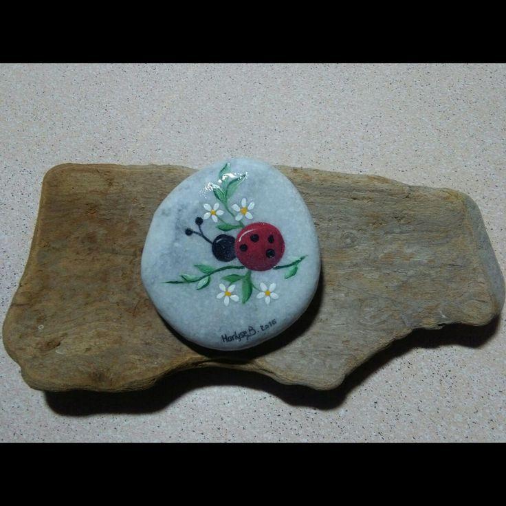 Ladybug rock painting