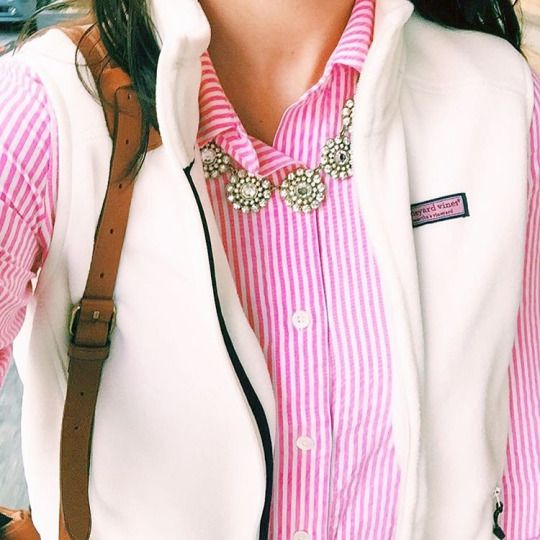 The necklace makes a great touch to this cheery pink collared shirt and white fluffy vest. Follow Lauren VaughAn to see more stylish pins.