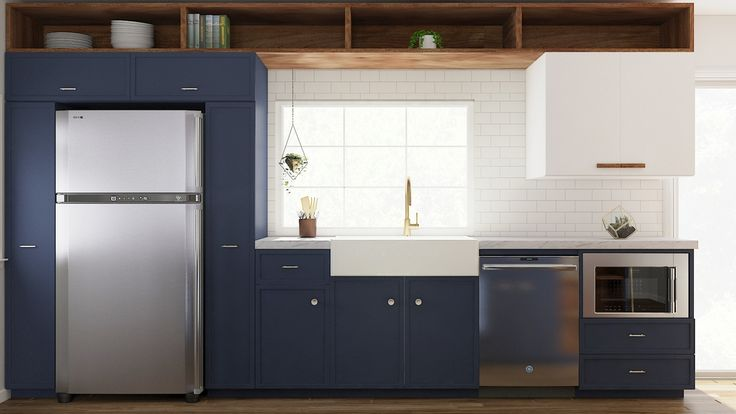 kitchen make over with blue painted cabinets, white farmhouse sink, gold faucet, white subway tile backsplash
