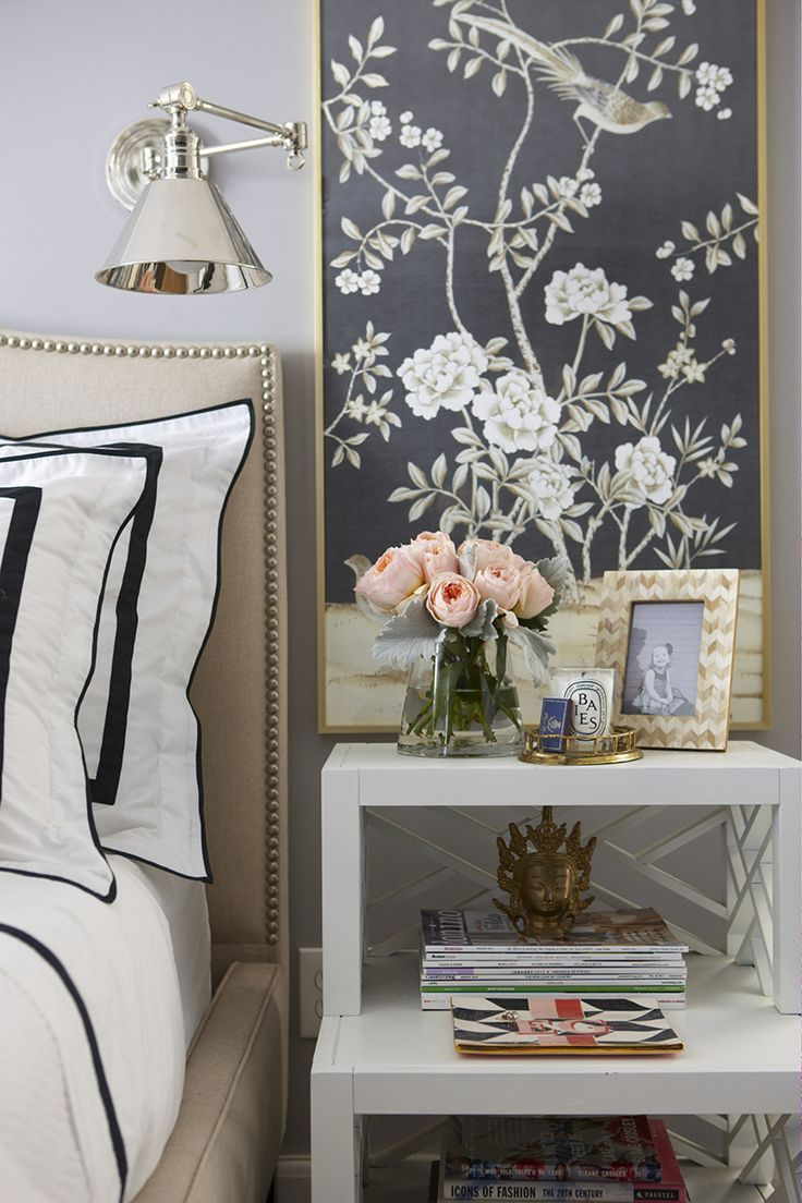 Give your bedroom an easy yet impressive makeover by hanging one or two framed chinoiserie pieces by your bed. Choose a striped duvet cover in a matching colour to make it work like a pro.