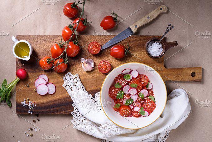 tomato salad on wooden board by Iuliia Leonova on @creativemarket