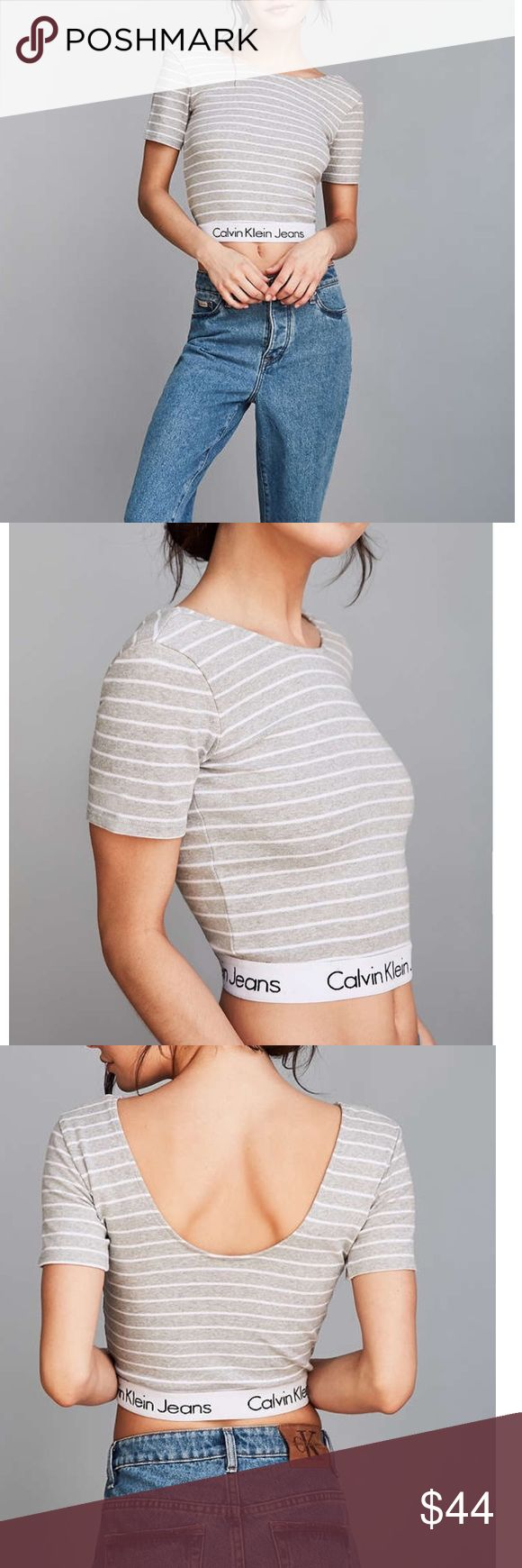 Calvin Klein For UO Stripe Cropped Tee Calvin Klein For UO Stripe Cropped Tee. Slim & stretchy crop fit, trimmed with brands iconic stretch logo band, scoop neck in back, urban outfitters exclusive Urban Outfitters Tops Crop Tops