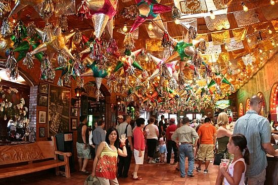 Mi Tierra in San Antonio. This is the BEST Mexican food resturaunt. It's so authentic and unique and they're open 24/7!! How weird but they have AMAZING tamales...If your gonna travel for mexican food, heres the place to go! So good..!