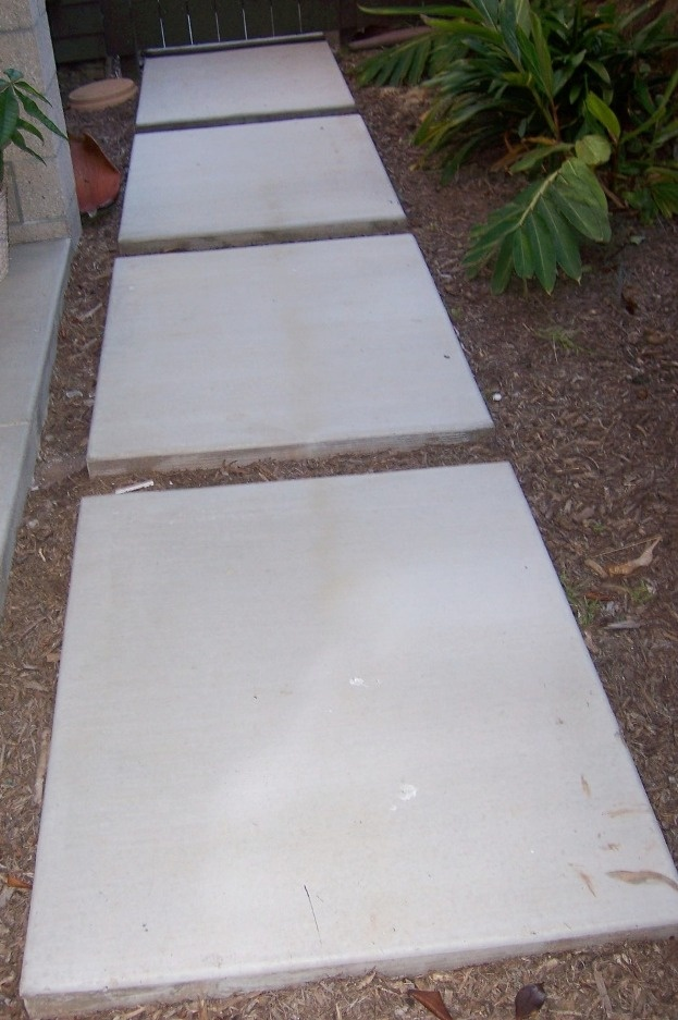The floating concrete pathway is a good way to crfeate a modern style of entry way into your garden.  There are over 600 garden photos to inspire you on the 2 MInute Gardener photo blog.