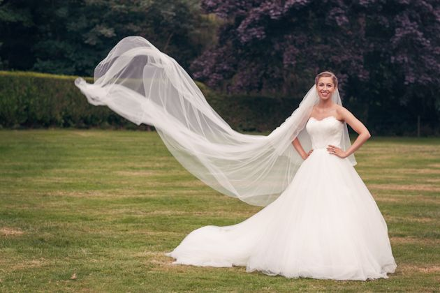 Beautiful bride in an amazing Swan Lake esque gown with a feathered bodice and huge tulle skirt