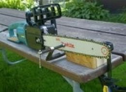 Chainsaw Filing Clamps - Homemade chainsaw filing setup comprised of a wooden support block and woodworking clamps.