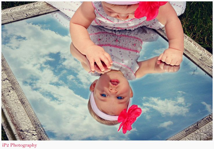 6 month baby photography - would be good with an all white reflection, plainer mirror, or white simple outfit.
