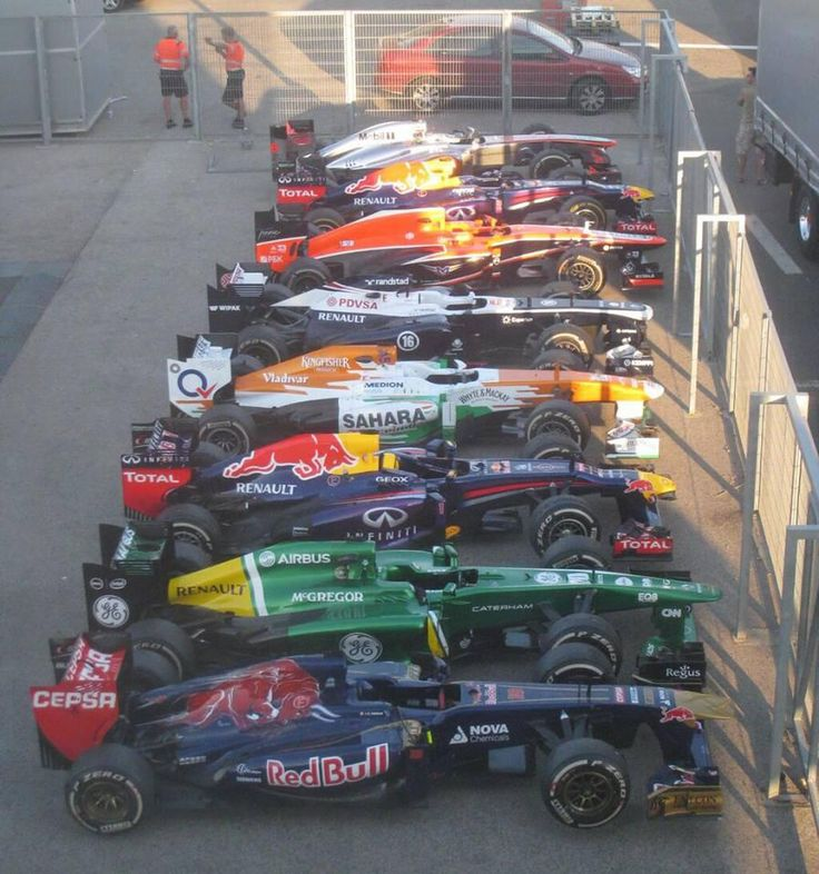 In honor of the upcoming F1 Grand Pix Night Race in Singapore, here they are lined up, revving and waiting. What does a race car smell like? #soluxairfresheners in X-Speed!