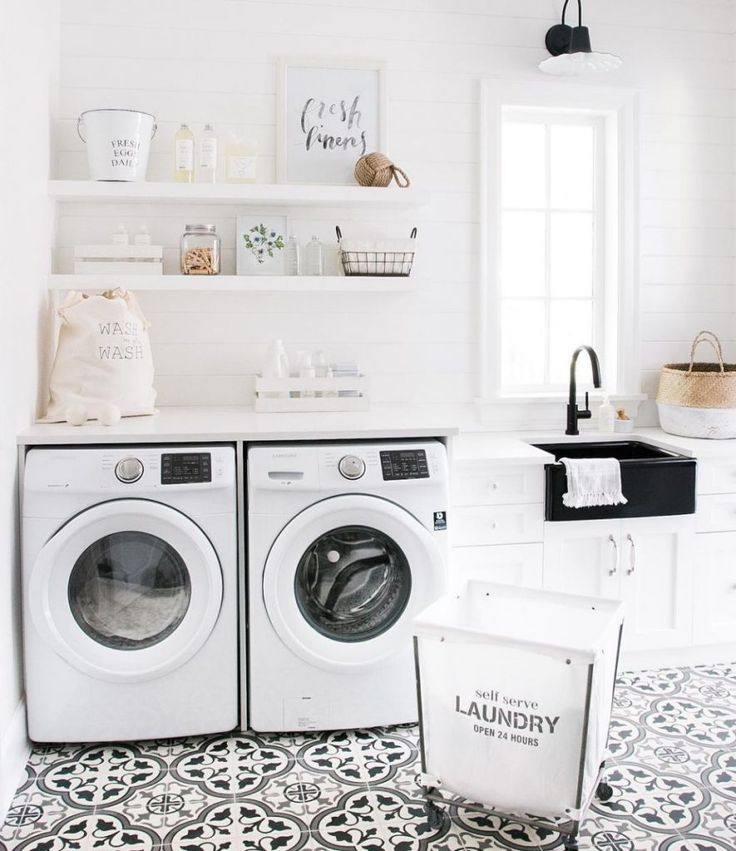 A black and white laundry room where tile is a graphic focal point.