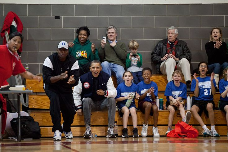 President Obama and Reggie Love, second from left, coaching Sasha Obama's basketball team in February...
