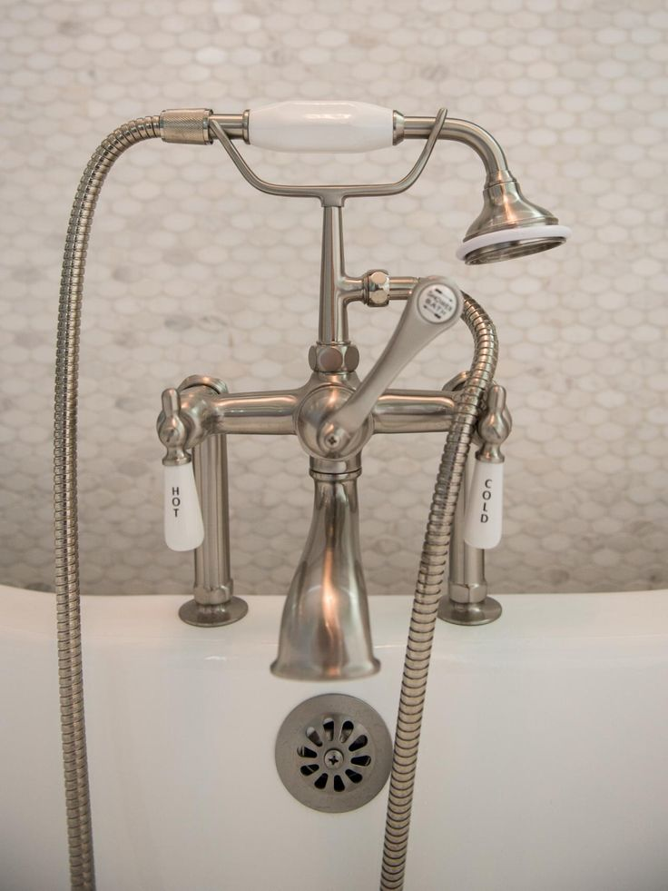 This traditional bathtub faucet also features a handheld shower head to get you squeaky clean.