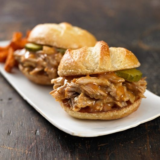 Ingredients    1 boneless pork shoulder roast (3 to 4 pounds)    Salt and ground black pepper    2 teaspoons paprika    ¼ cup spicy brown mustard    ¼ cup packed brown sugar    3 cloves garlic, minced    1 cup apple cider or apple juice    1 package (15 ounces) slider or mini sandwich buns (12 mini buns)