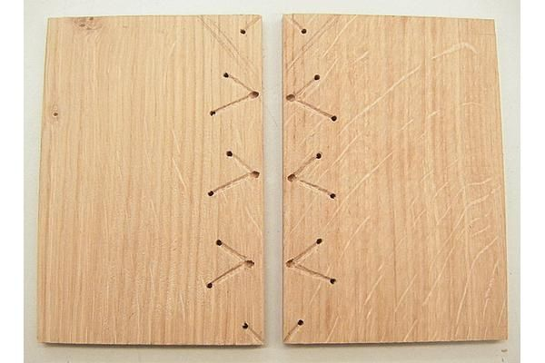 W7: (Historical Binding: A Carolingian Cutaway Model) In this reconstrunction we see the method of using wooden boards with holes and lines for the sewing.