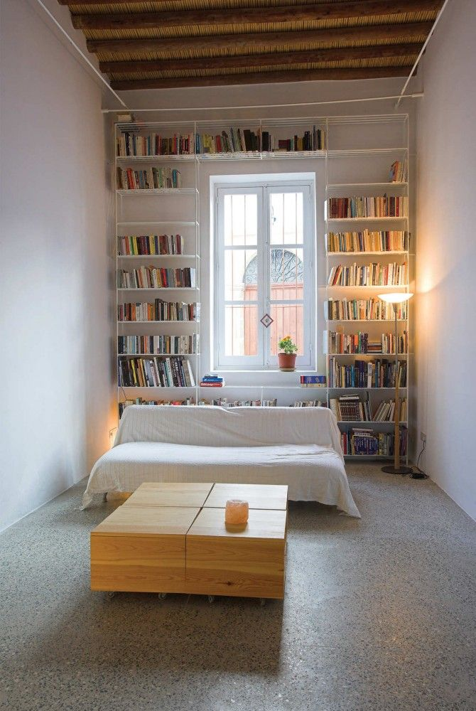 Always love books surrounding a window or doorway - House In Kaimakli, Cyprus by Yiorgos Hadjichristou Architects.