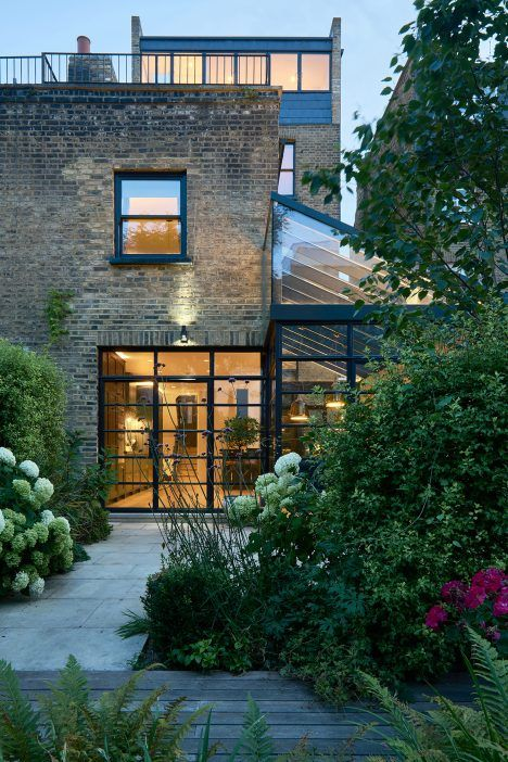 This 100-square-metre extension was designed to provide a new open-plan kitchen and dining room for a large family living in a four-storey Victorian terrace.