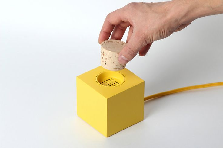 An Adorable Square Speaker Activated By A Cork Plug