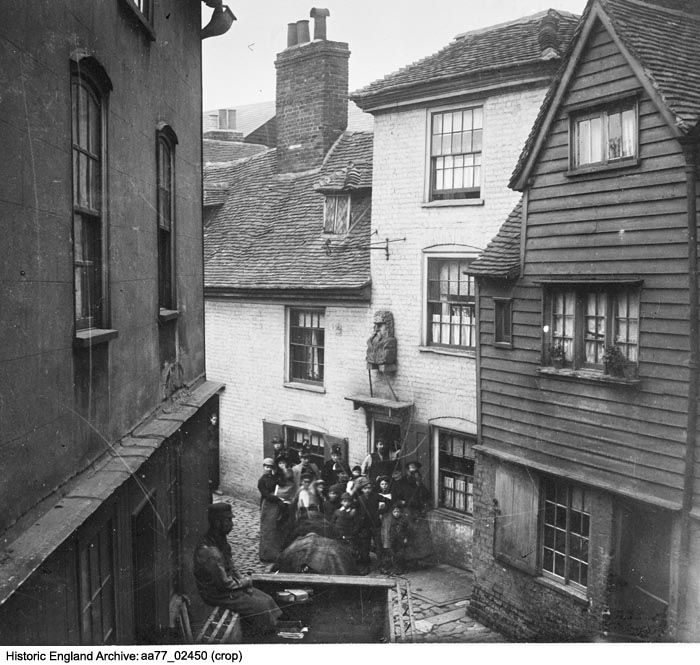 AA77/02450 An elevated view showing a group of people outside The Old Parrs Head public house, George Lane, Rochester, Medway.  Date 1862 - 1867