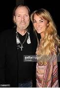 Gregg Allman and his fiancee Shannon Williams pose backstage at the ...