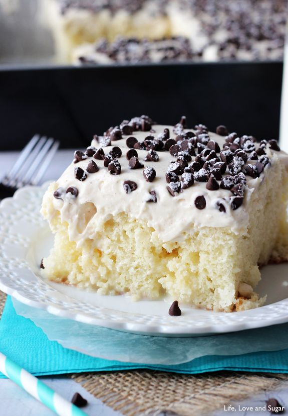 Cannoli Poke Cake - You are going to love this cake! A vanilla cake, soaked with sweetened condensed milk, covered in sweet cannoli filling. Ah-mazing!